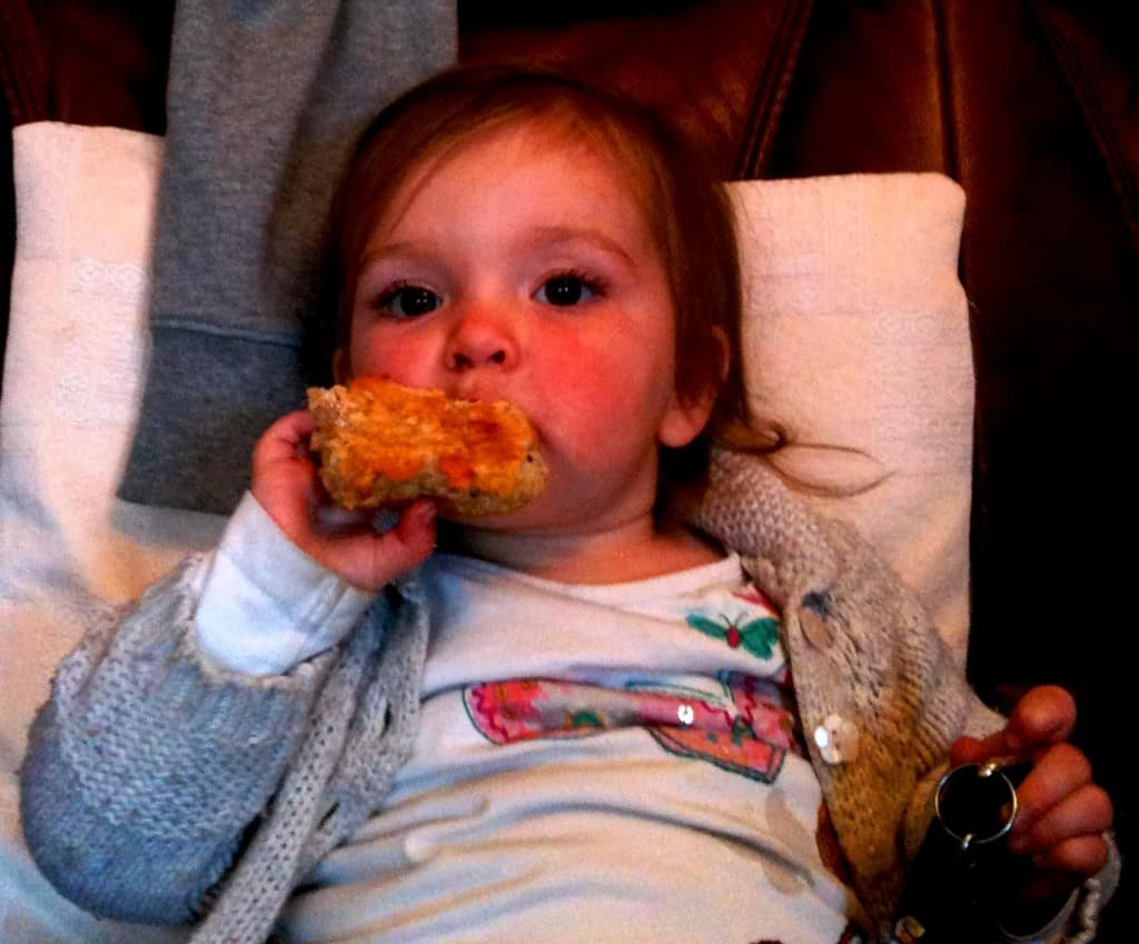 Ellie enjoying one of my cheese and onion scones
