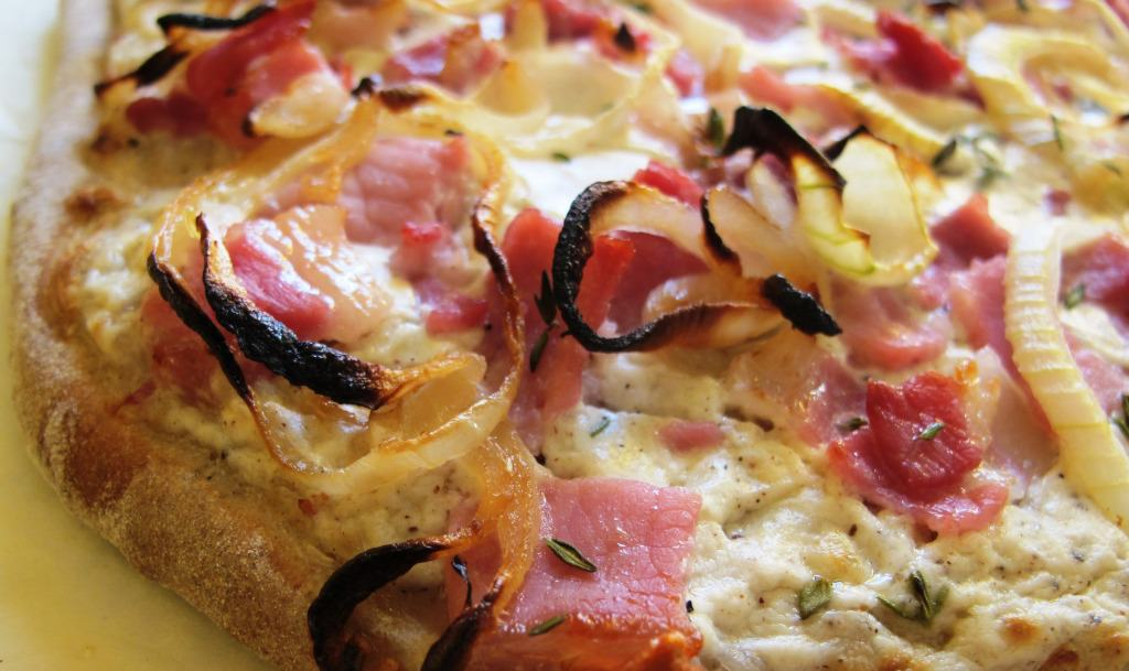 German Flammkuchen recipe using onions, sour cream, bacon