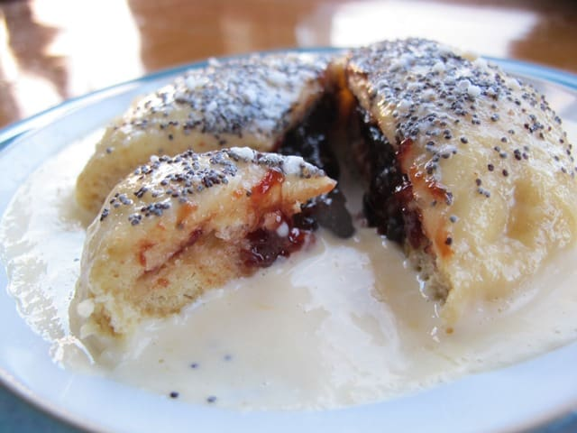 Germknoedel filled with Powidl, served with poppy seeds and vanilla sauce